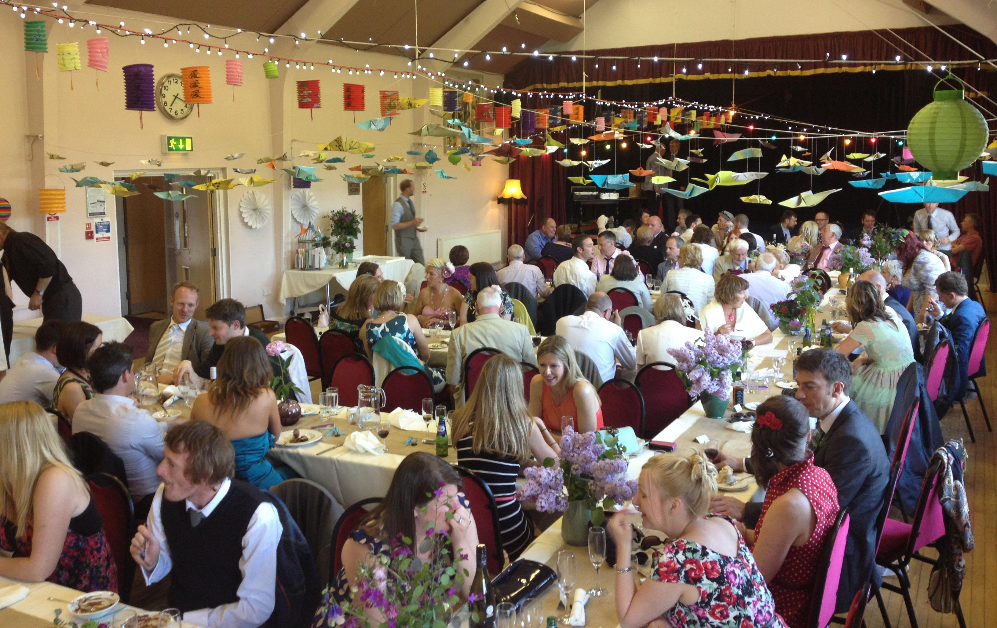 Long, sociable tables at an Ashover Parish Hall wedding reception.